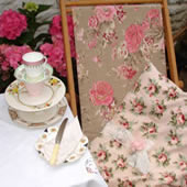 Old-fashioned deckchair & cushion covered in vintage flora fabric
