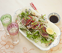 Salad on Retangular Serving Dish and Coloured Glasses