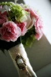 bouquet tied with vintage brooch