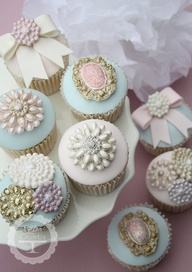 cupcakes topped with vintage style icing brooches